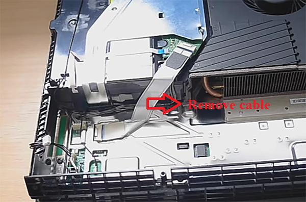 Remove blue ribbon cable; PS4 console